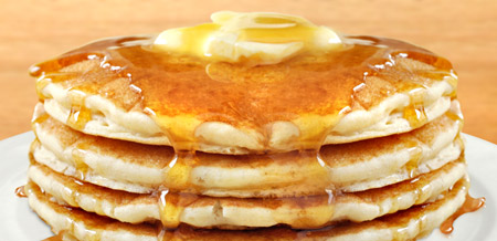 Hot pancakes with butter and syrup